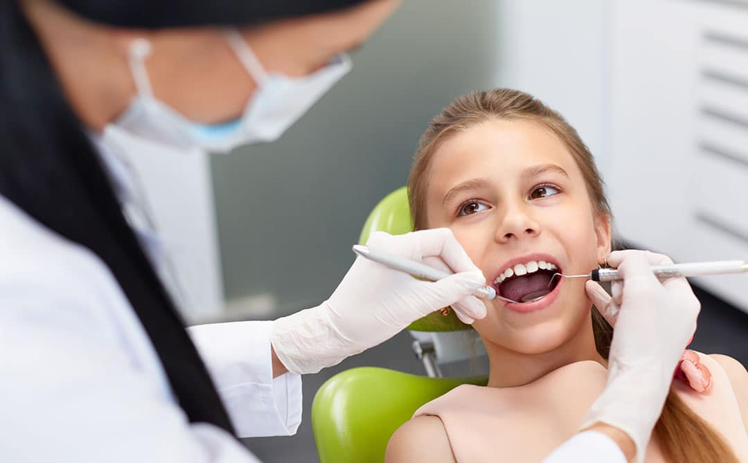 Dentist preventing cavities